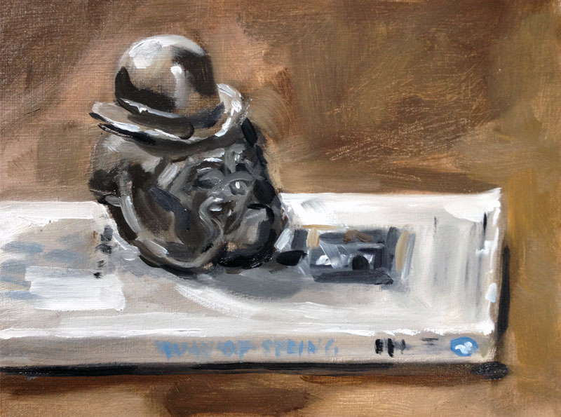 Painting of a bulldog paper weight on a book