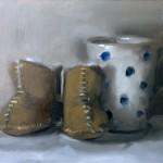 Still life oil painting of babies boots and a mug by Helen Davison