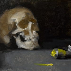 Still life oil painting of a skull and tube of cadmium yellow oil paint by Helen Davison